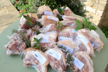A half pig butchered, packed and labelled ready for the freezer